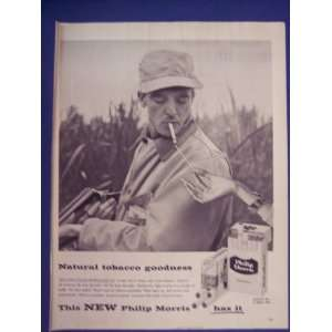 Philip Morris cigarettes, man getting light from woman, Print Ad